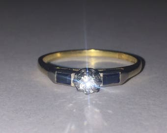 An Art-Deco Sapphire and Diamond Dress Ring in 18K Gold & Platinum. Circa 1940's.