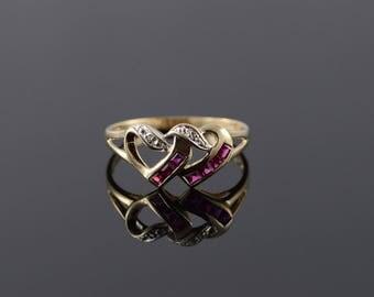 10k 0.51 CTW Ruby* Diamond Interlocking Heart Ring Gold