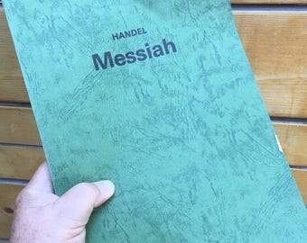 Vintage 1982 Handel's Messiah music score. Textured paperbound music score of Handel's Messiah.