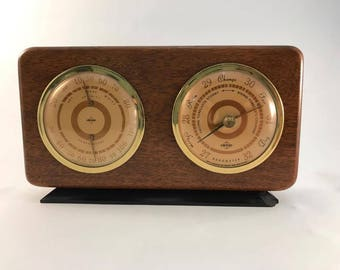 Mahogany Weather Station with Barometer, humidity level, and temperature gauge Swift & Anderson Inc. Boston Mass. Mid Century