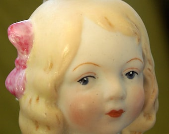 Serene faced porcelain girl with movable arms