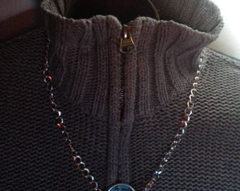 a handmade necklace with a mesh chain silver color horse