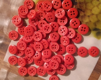 Set of 90 small red glass buttons