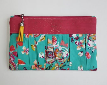 Teal floral wristlet with cork accent