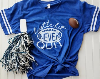 Hustle, Hit, Never Quit Football Tee in Royal, Red, or Charcoal