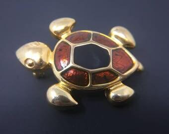 Gold tone enameled turtle pendant