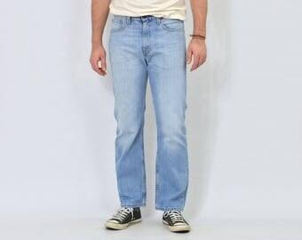 Levi's jeans W32 L30 blue trousers vintage pants straight fit leg hipster 1990's mens M/L