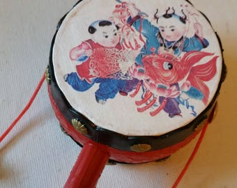 Chinese toy drum noisemaker