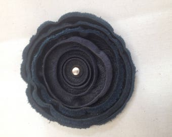 a blue leather flower brooch