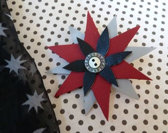 Accessory studs brooch and pin black grey red leather