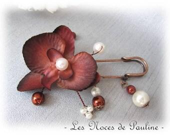 Fastener behind Brown and Ivory Pearl flower wedding b