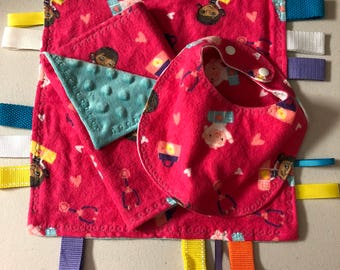 Tag ribbon blanket with matching bib and burp cloth