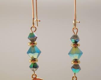 Earrings with blue Svarovski beads and lovely bird