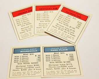 Set of blue and red Monopoly deeds-1973 set of monopoly cards