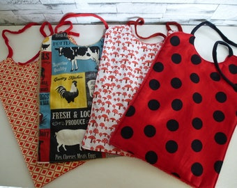 set of 4 bibs has lace in shades of Red