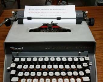 1958 gray Remington Quiet-Riter Eleven with cursive (script) font