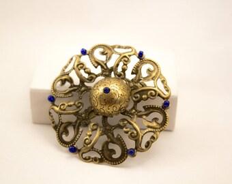 Bronze colored filigree vintage brooch.