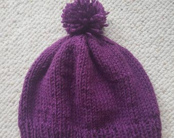Purple pompom hat