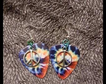 The she guitar pick earrings