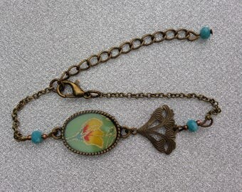 Bracelet turquoise Japanese paper with yellow and red flower.