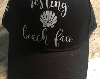 resting beach face trucker hat