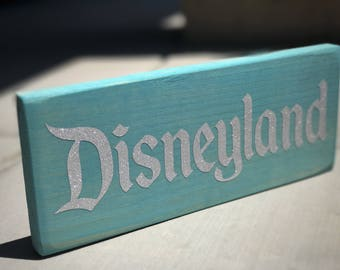Teal Wooden Sign with Glitter Disneyland Logo