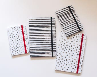 Polka dots, black and white ink stripes, black and white journal with first and the last page in color, large size has back pocket