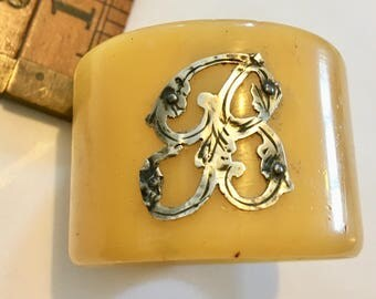 bakelite early 20th century with silver letter