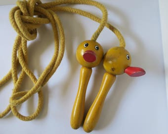 Vintage yellow wooden duck jump rope