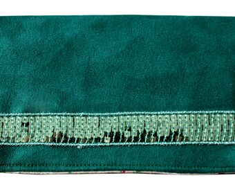 Glitter band and green checkbook holder