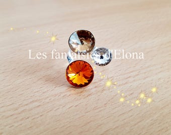 925 sterling silver ring with orange/gold/white color swarovski crystal rhinestones.