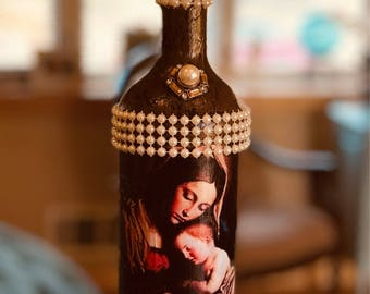Decorated recycled bottle.  Religious.  Virgin  Mary.  Baby Jesus.  Pearls.  Faith