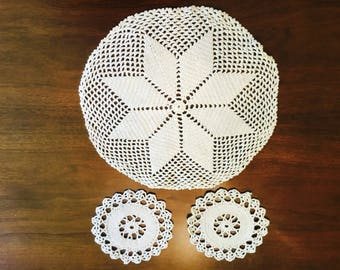 Set of three hand made doilies.