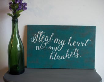 Hand painted sign on repurposed particle board 'Steal my heart not my blankets'
