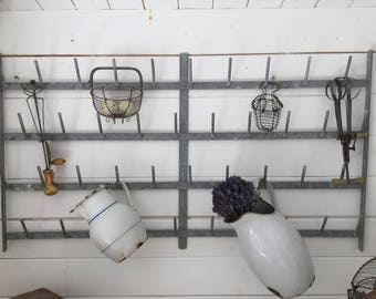 Ancient wall bottle dryer, France, shabby