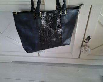 Bag has black sequined band