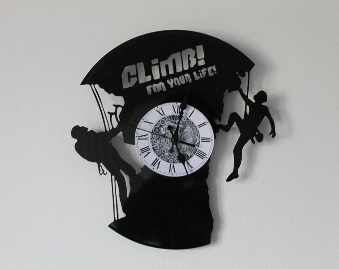Vinyl 33 clock turns climbing theme