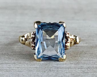 Light blue synthetic spinel vintage ring in yellow gold