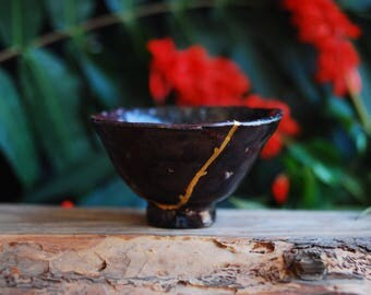 Ceramic kintsugi raku teabowl for tea ceremony