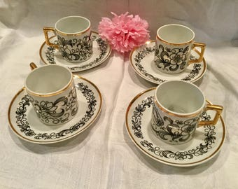 Set of four (4) German china demitasse cups and saucers