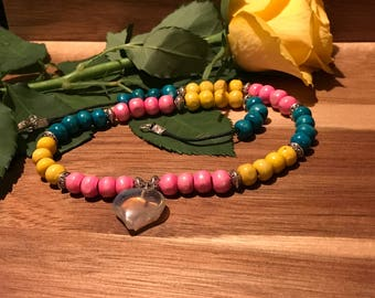 Handmade eyecatching brightly coloured wooden beaded quartz corded necklace
