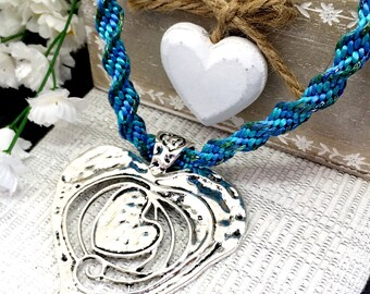 Statement figured silver heart pendant, braided, Matinee length