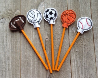 Sports themed pencil toppers