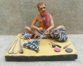 Beautifully made vintage unfired clay figurine of an umbrella maker, from Calcutta Free shipping .