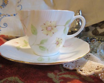 beautiful Rosina tea cup and saucer, Queen's china, rippled cup, dainty pink and yellow flowers, embossed design, excellent condition,