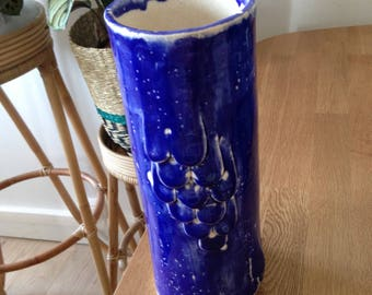 Vase blue scales and bubbles