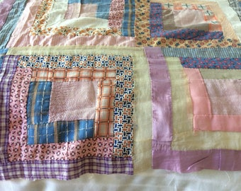 Vintage quilt top.  1930's , hand stitched.  A lot of 1920's romantic fabric. Log cabin design. Pink, peach, lavender and blues.  Beautiful.