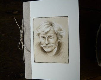 "Small notebook with ""Jean Ferrat"" illustration"