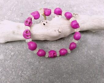 thin elastic bracelet made of skulls pink plastic