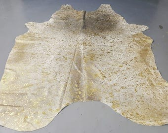 large brazilian metallic gold on grey cow hide rug 85 by 77 inches